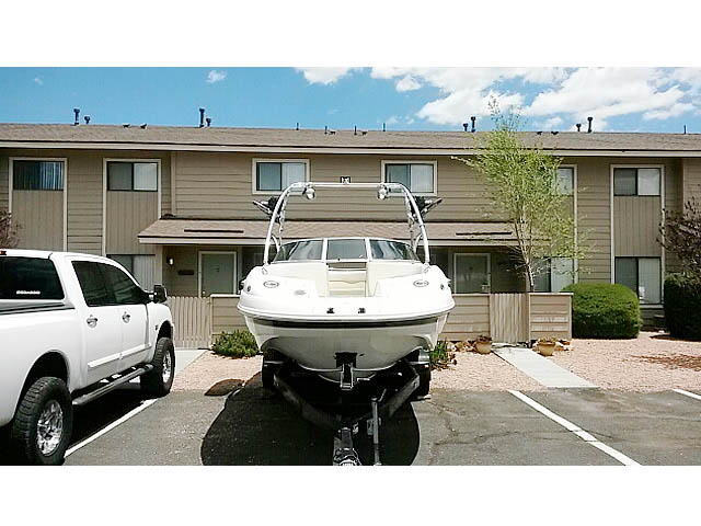 2004 Chaparral 234 wakeboard tower, speakers, racks, bimini & lights