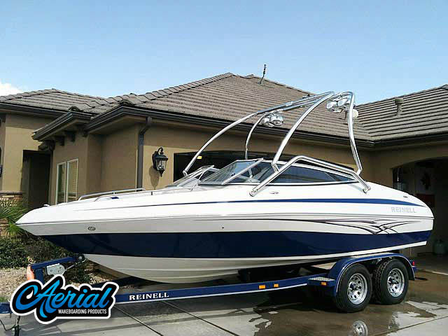 Customer photo of their boat with installed Aerial universal wakeboard tower, speakers, racks, bimini and wakeboard accessories