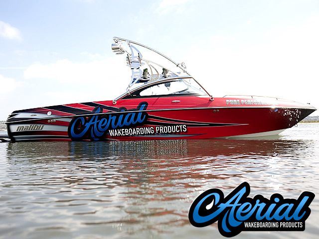 Angle view photo of Aerial Assault Wakeboard Tower with Integrated Navigation LED Light - Polished Aluminum with 2 Wakeboard Tower Racks installed with wakeboard tower accessories