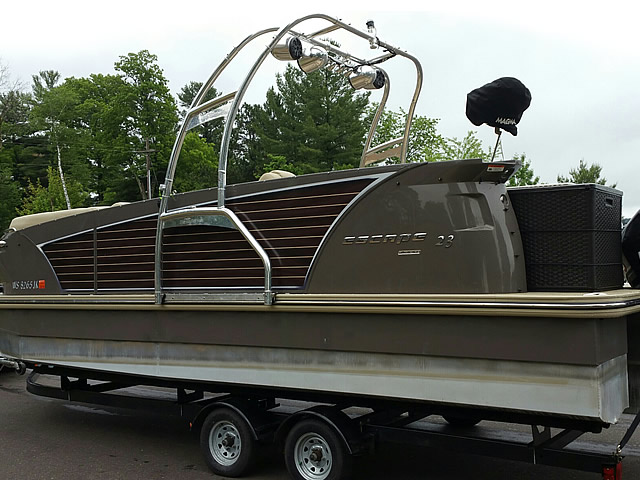 Angle view photo of Aerial WakeWorks F250 Universal Folding Pontoon Boat Wakeboard Tower installed with wakeboard tower accessories