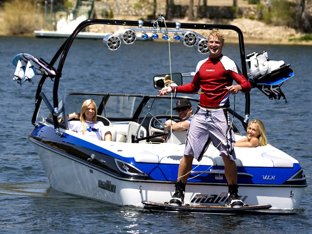 Photo of wakeboarder using a Aerial Airborne 2.0 Wakeboard Tower with Integrated Navigation LED Light - Black Powder Coated