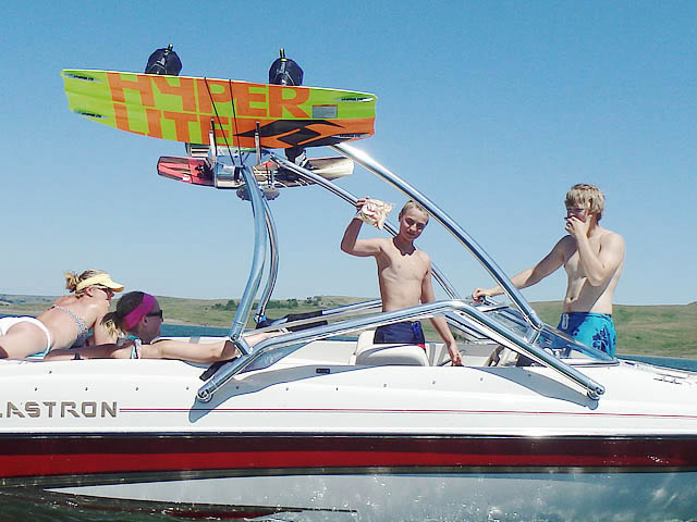 How a Aerial Airborne 2.0 Wakeboard Tower with Integrated Navigation LED Light - Polished Aluminum installs on a ski boat